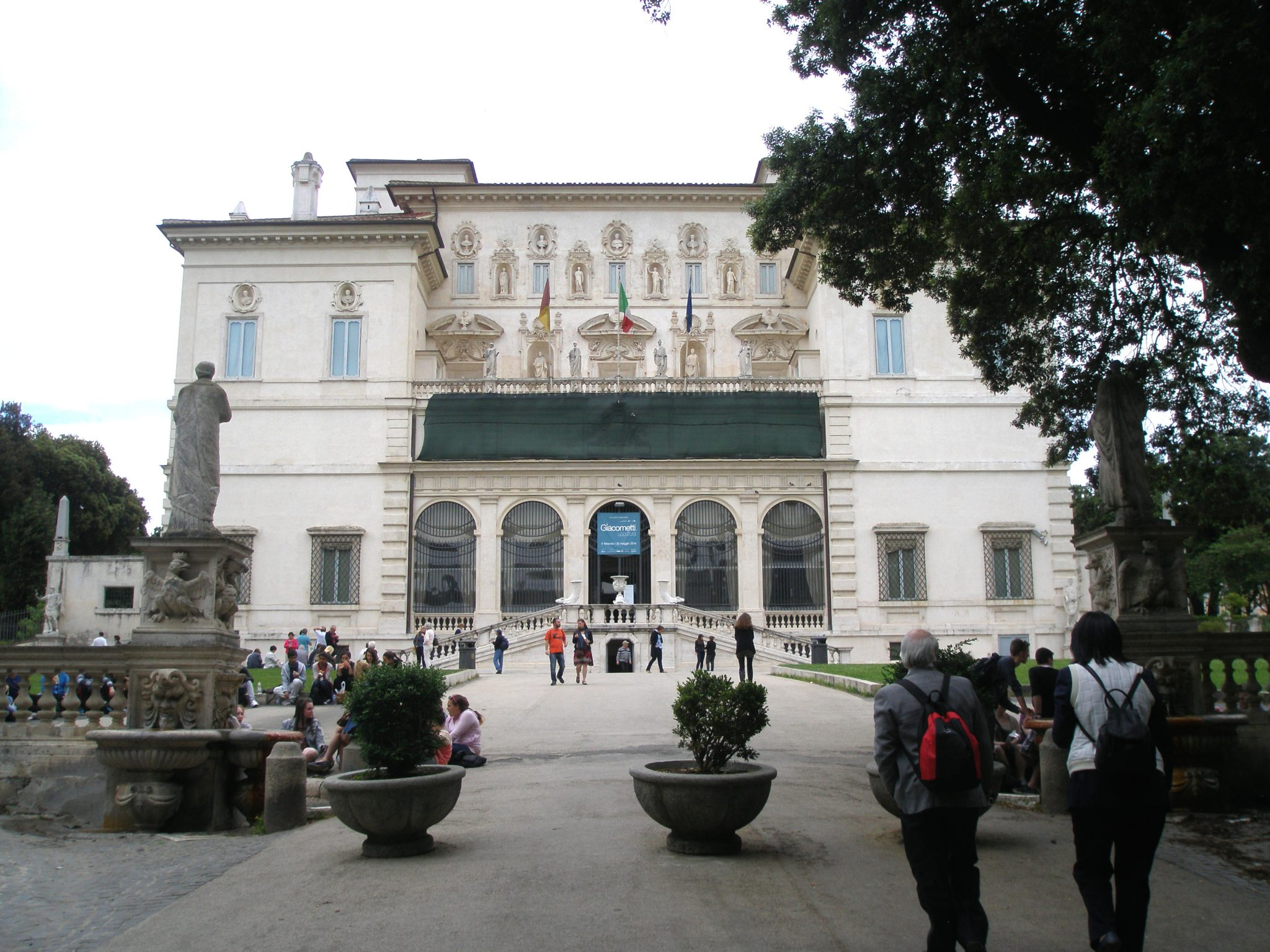 The Galleria Borghese. One enters the Galley on its south side, at basement-level, through the minuscule, central arch that's tucked beneath the double stairway which leads up to the Loggia.
