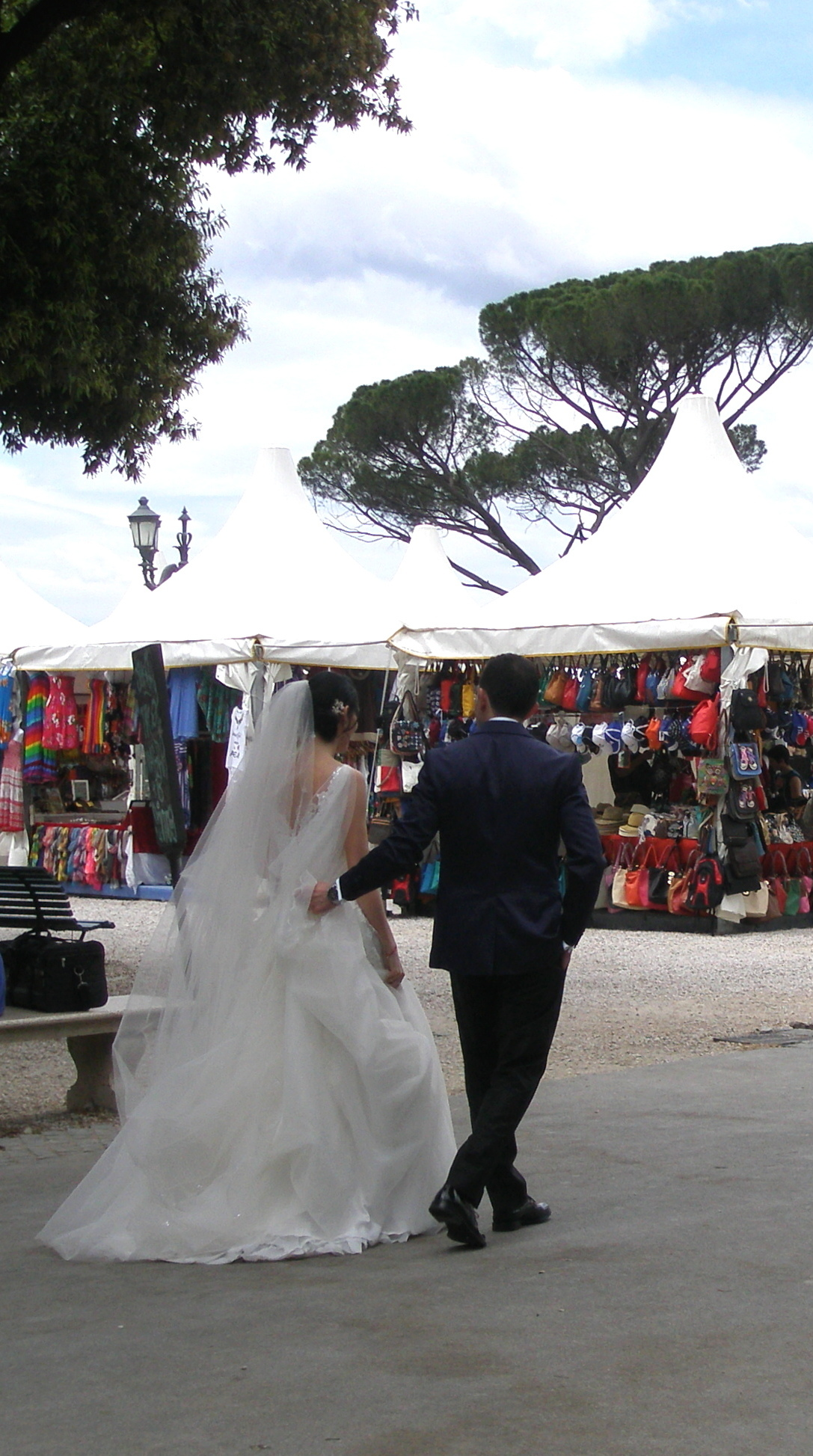 A bride and her groom promenade on Piazzale Napoleone