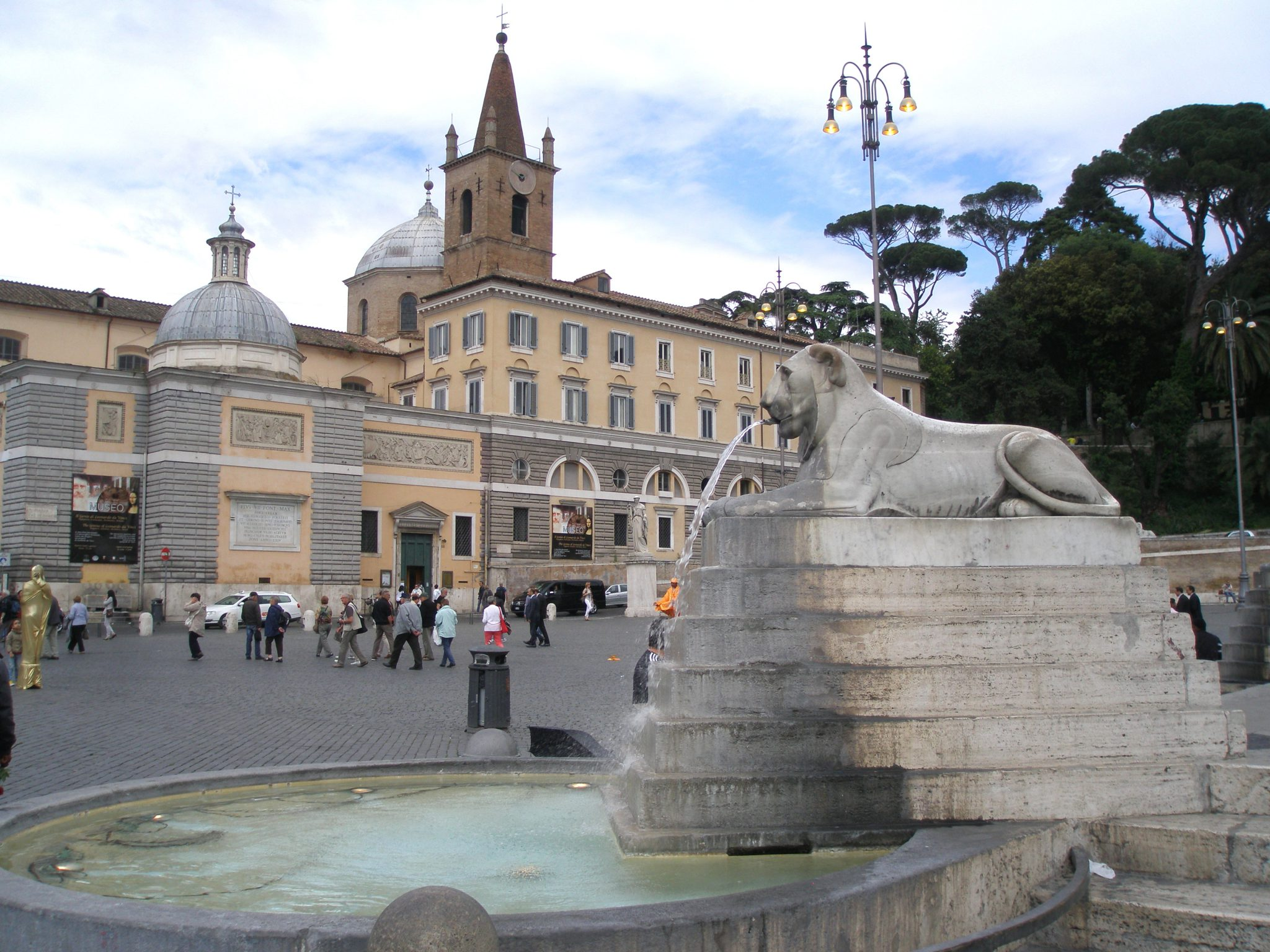 Piazza del Popolo. The Basilica of Santa Maria del Popolo is on the north side of the Piazza. Behind its Baroque facade, the main body of the church building erected in the late 1400s still stands.