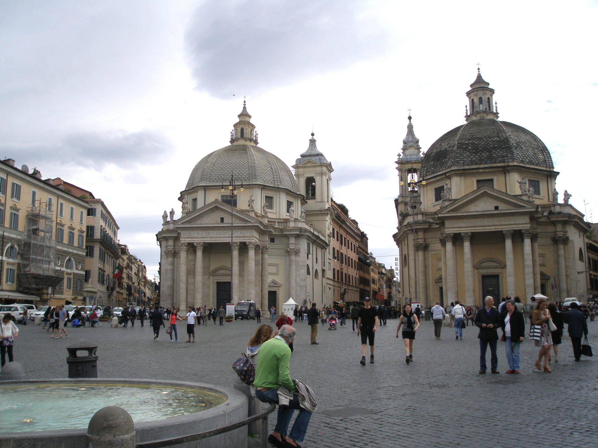 "The ""twin"" churches of Santa Maria in Montesanto (on the left), and Santa Maria dei Miracoli (right) define the southern edge of Piazza del Popolo."
