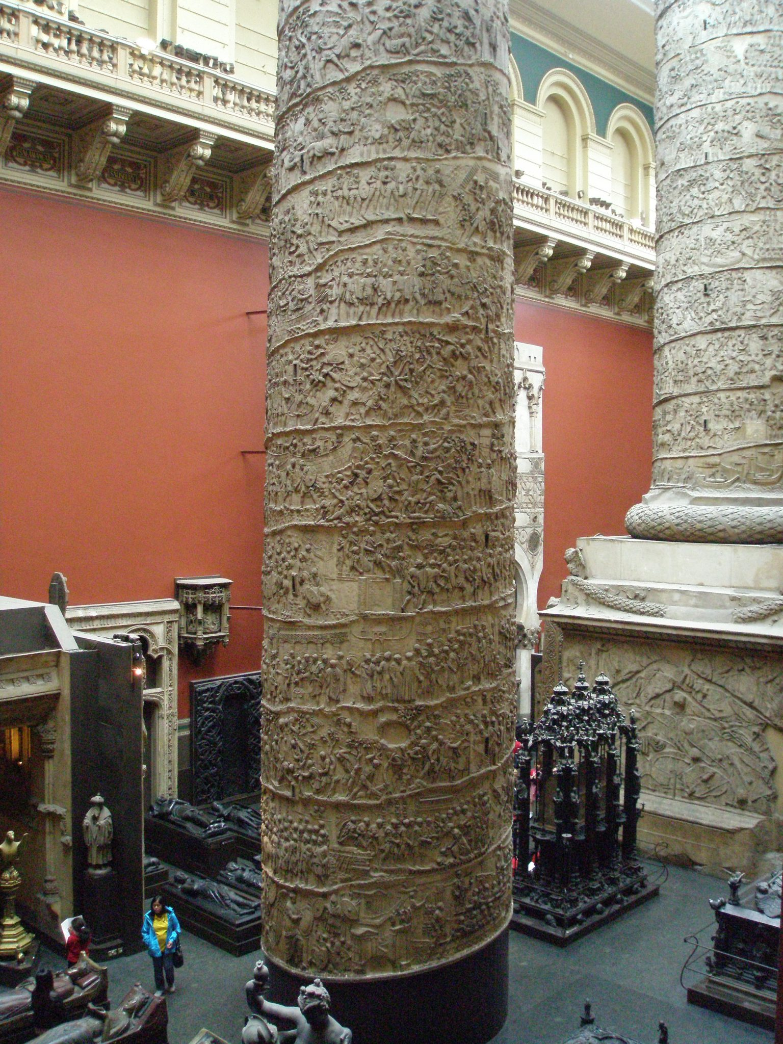 In the V&A Museum, the cast of Trajan's Column has been divided into two pieces, which makes the enormity of the Romans' Victory Columns even more apparent. The Cast Court Galleries were opened in 1873. From the Museum's 2nd floor balcony vantage point, one can see the top-most portions of the columns, up close.