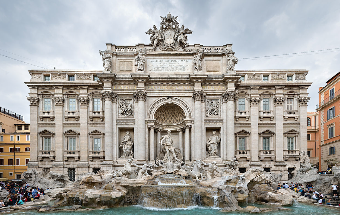 The full expanse of the Trevi Fountain, and the Palazzo Poli. Image courtesy of Wikipedia.
