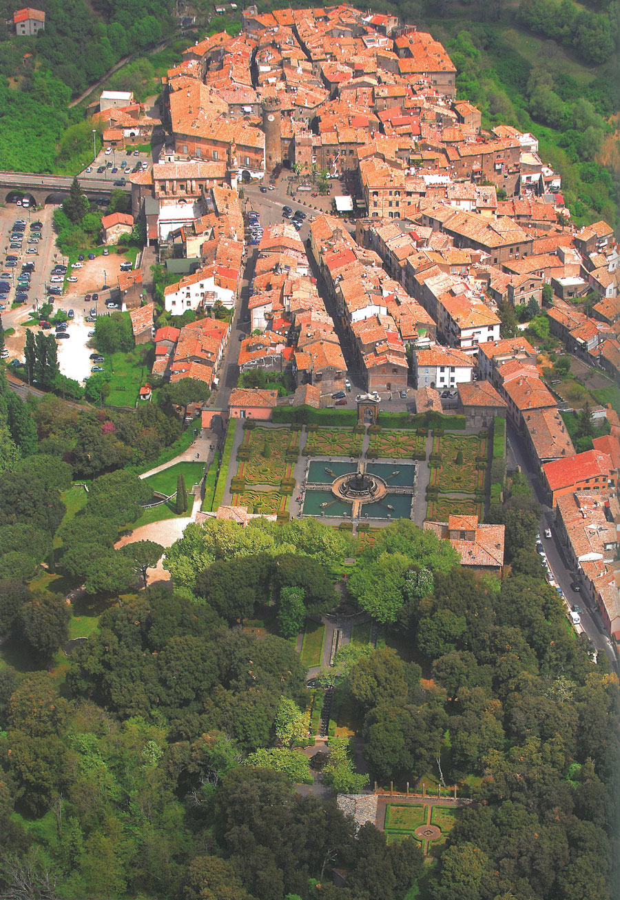 Aerial view of the Gardens of Villa Lante (foreground), and the Village of Bagnaia (background). Image courtesy of Il Pegaso Bookshop, in Bagnaia.