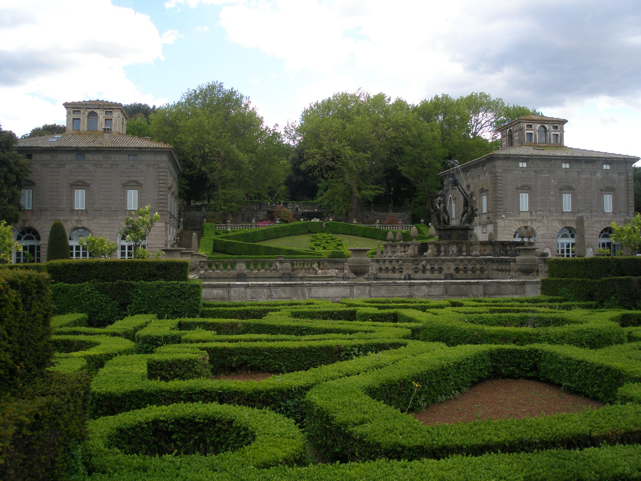 Palazzina Montalto (on the left) and Palazzina Gambara (on the right), as viewed from within the boxwood parterres that surround the Fountain of the Moors.