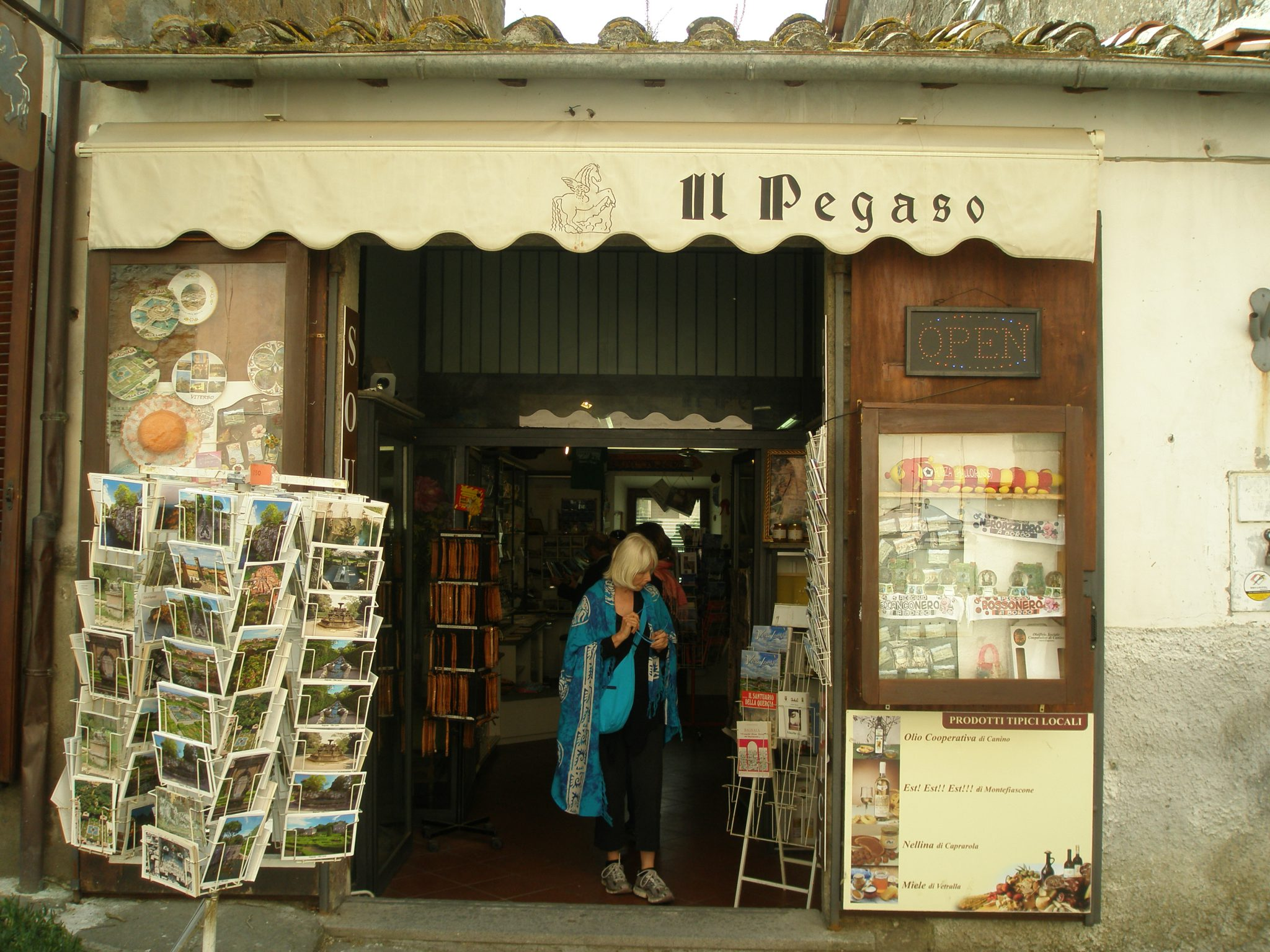 Donn inspects the goods. Il Pegaso Bookshop is located near the Gates to Villa Lante, on Via Jacopo Barozzi, in Bagnaia