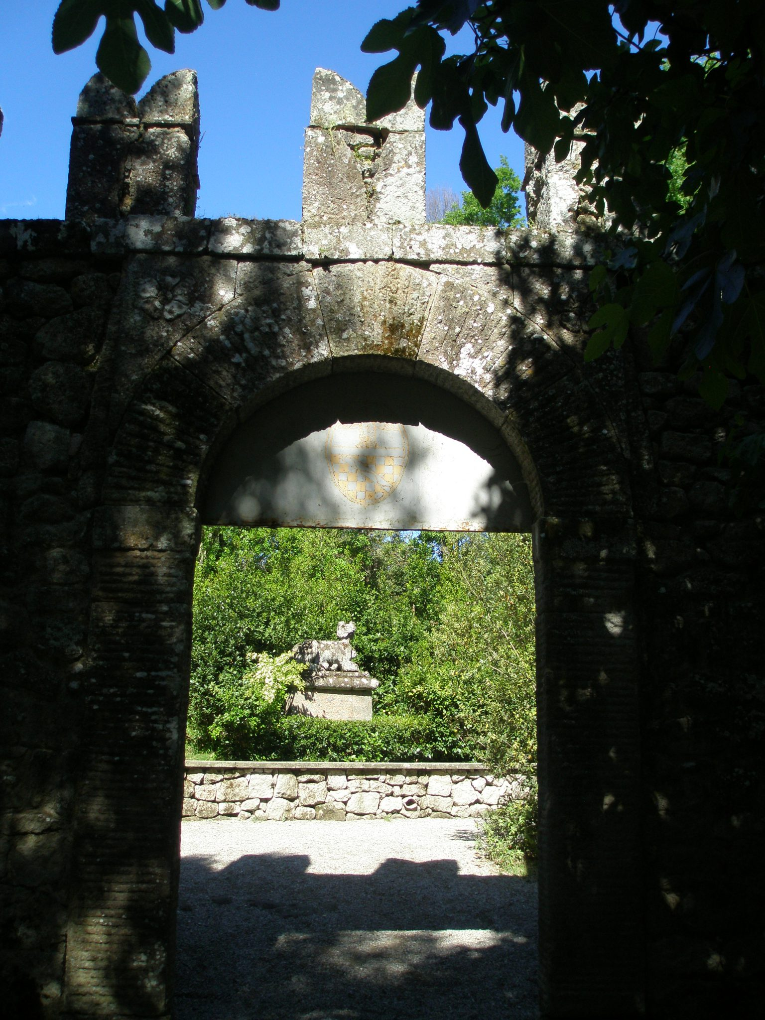 Gate to Garden, with view of a Sphinx, just inside.