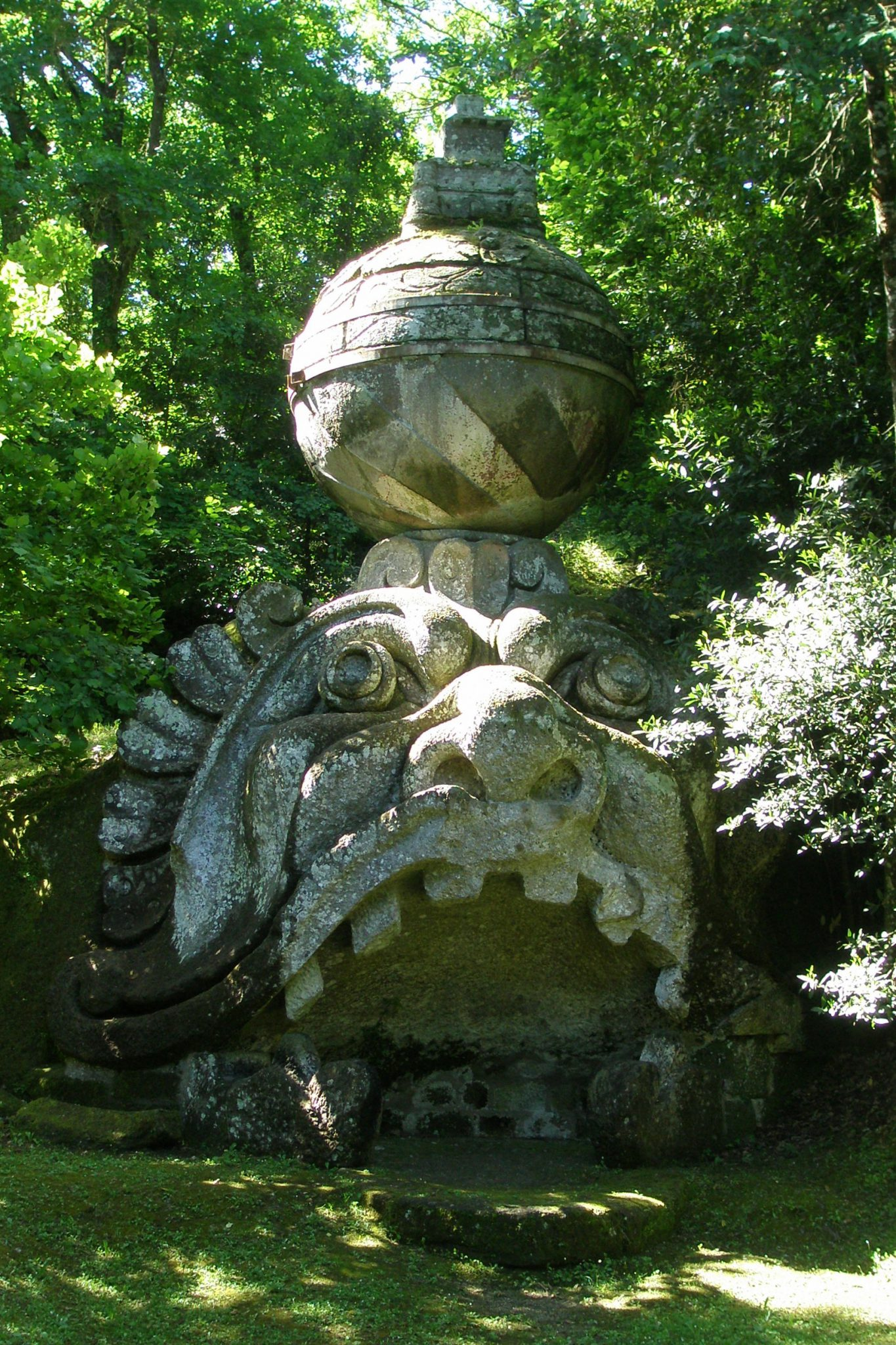 "A closer look at the ""Mask of Madness."" Traces of the original color can still be seen on the globe. Many of the statues at Bomarzo were decorated in vibrant colors; the pigments mixed with a secret formula that included milk, and which thus remained unfaded by weather."