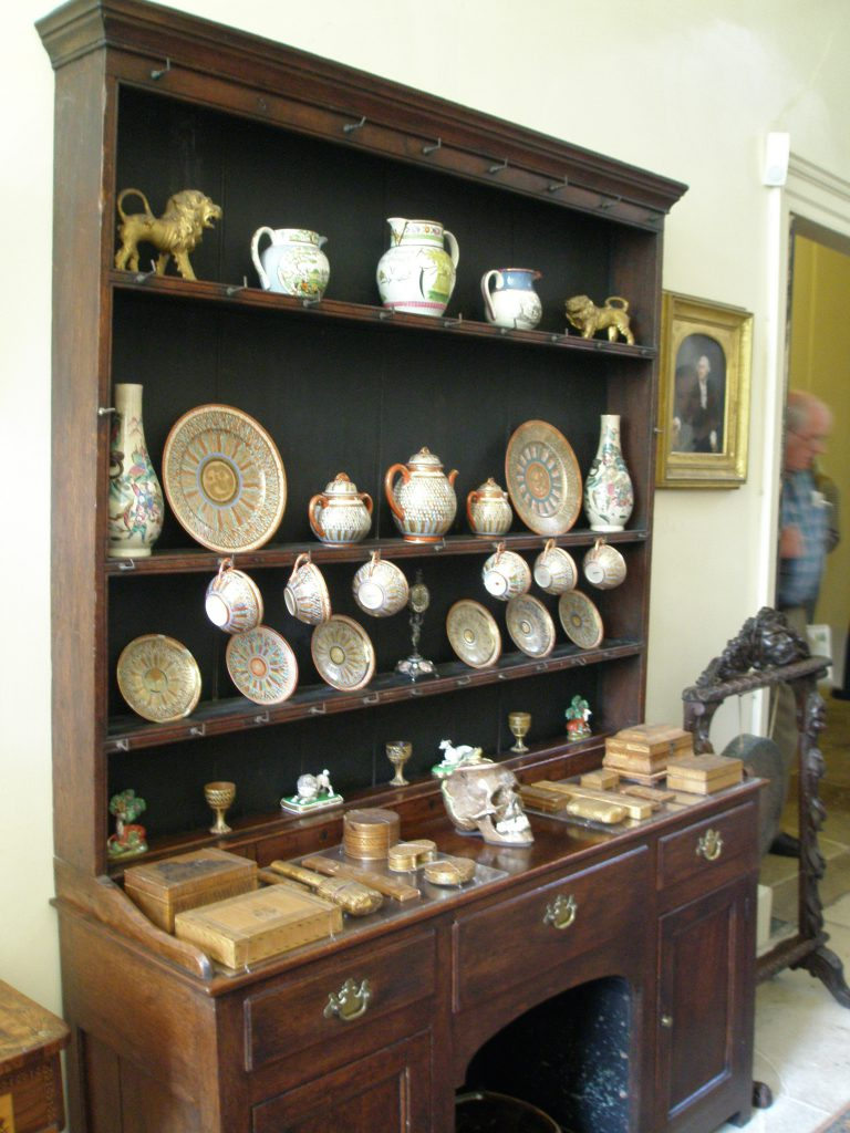A heavily-laden Cupboard in the Front Hall