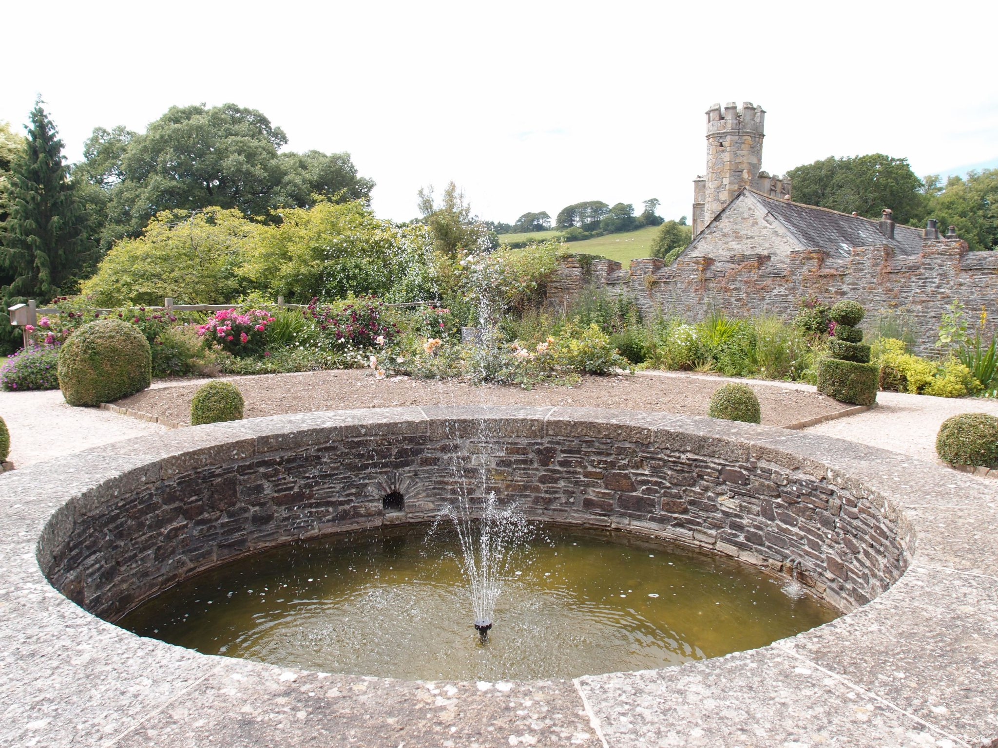 Central Pool in the Elizabethan Garden, with the Abbot's Tower in the background.