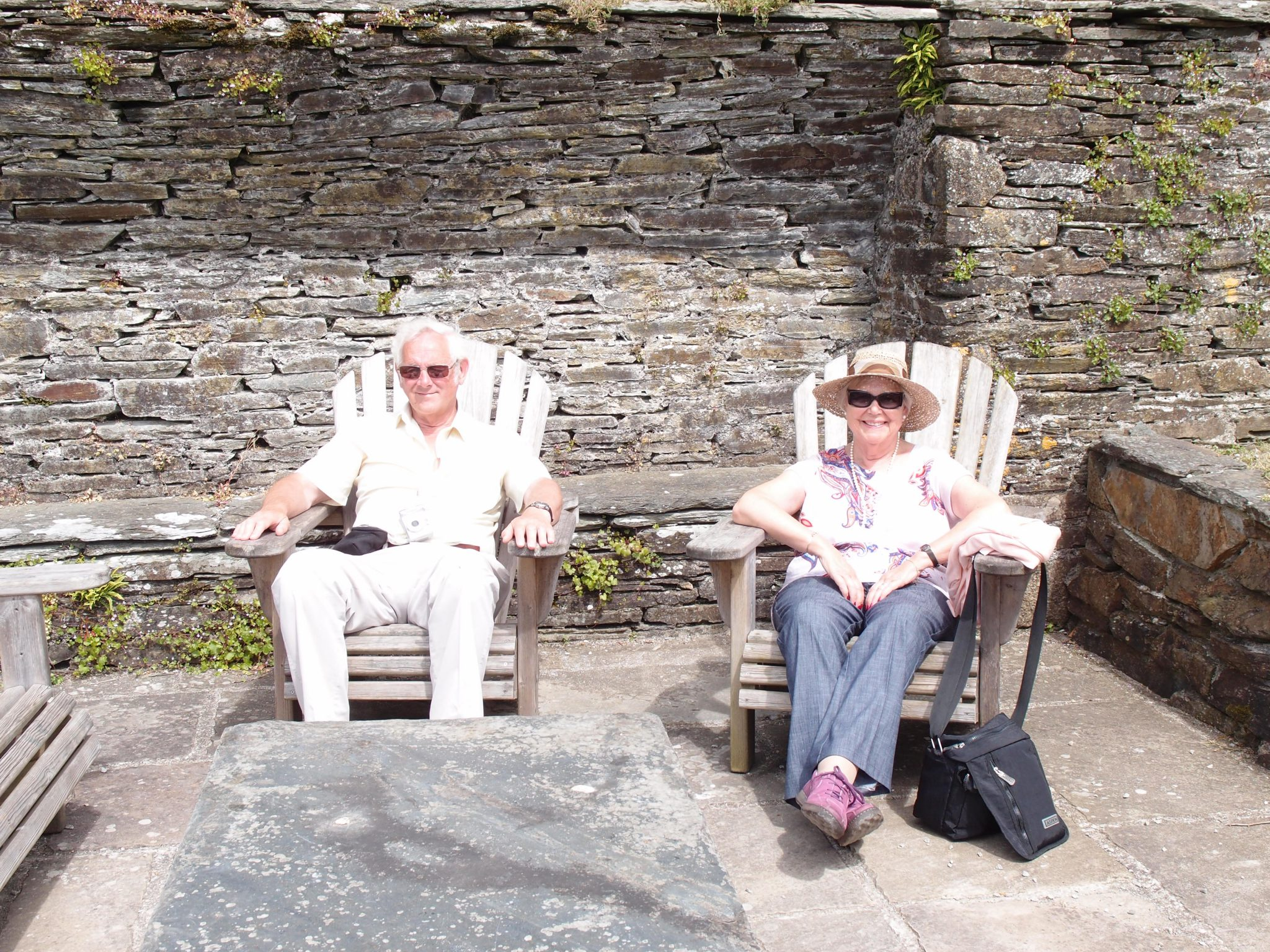 Barry and Janet rest in a sunny corner of the Kitchen Garden.