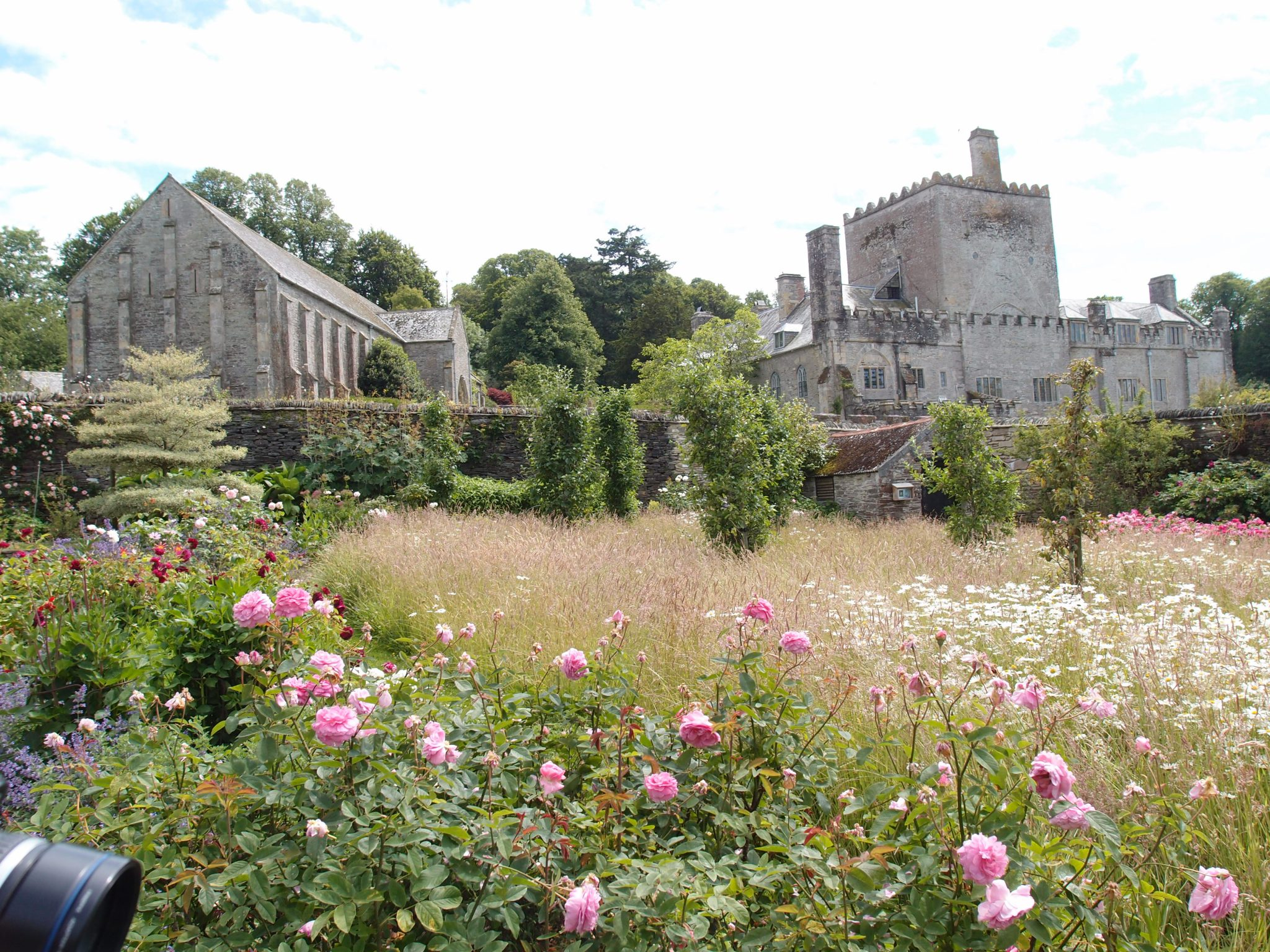 The Great Barn, and the Abbey, as seen from within the Kitchen Garden.