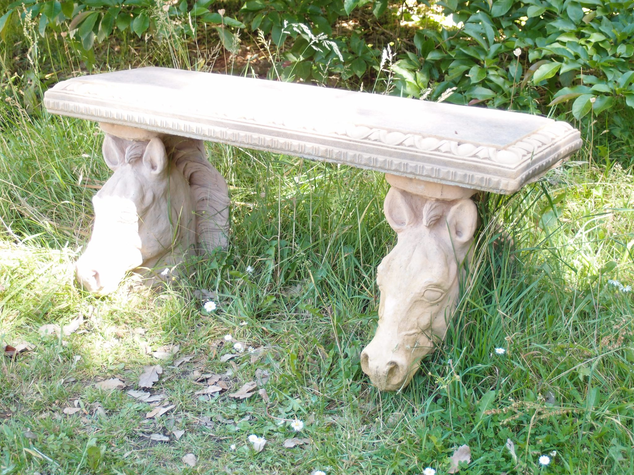 Just past the eastern gate to the Cider House Garden, we came upon this beautiful but slightly disturbing bench. (Horses' heads immediately lead to thoughts of that grisly scene in GODFATHER ONE.)