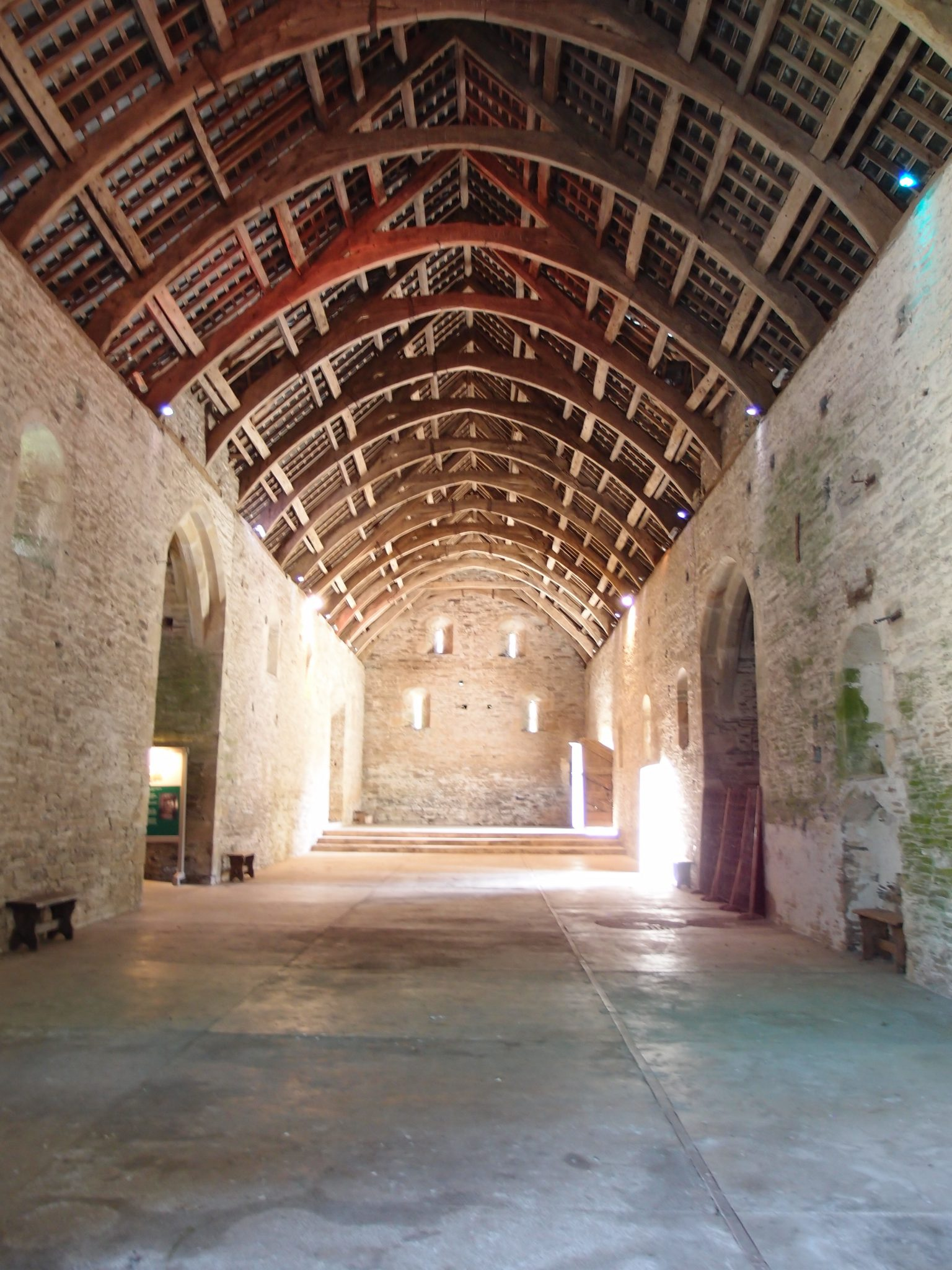 My view, looking toward the south end of the Great Barn. The walls date from 1300, and the arch-braced wooden roof was constructed in the 15th century.
