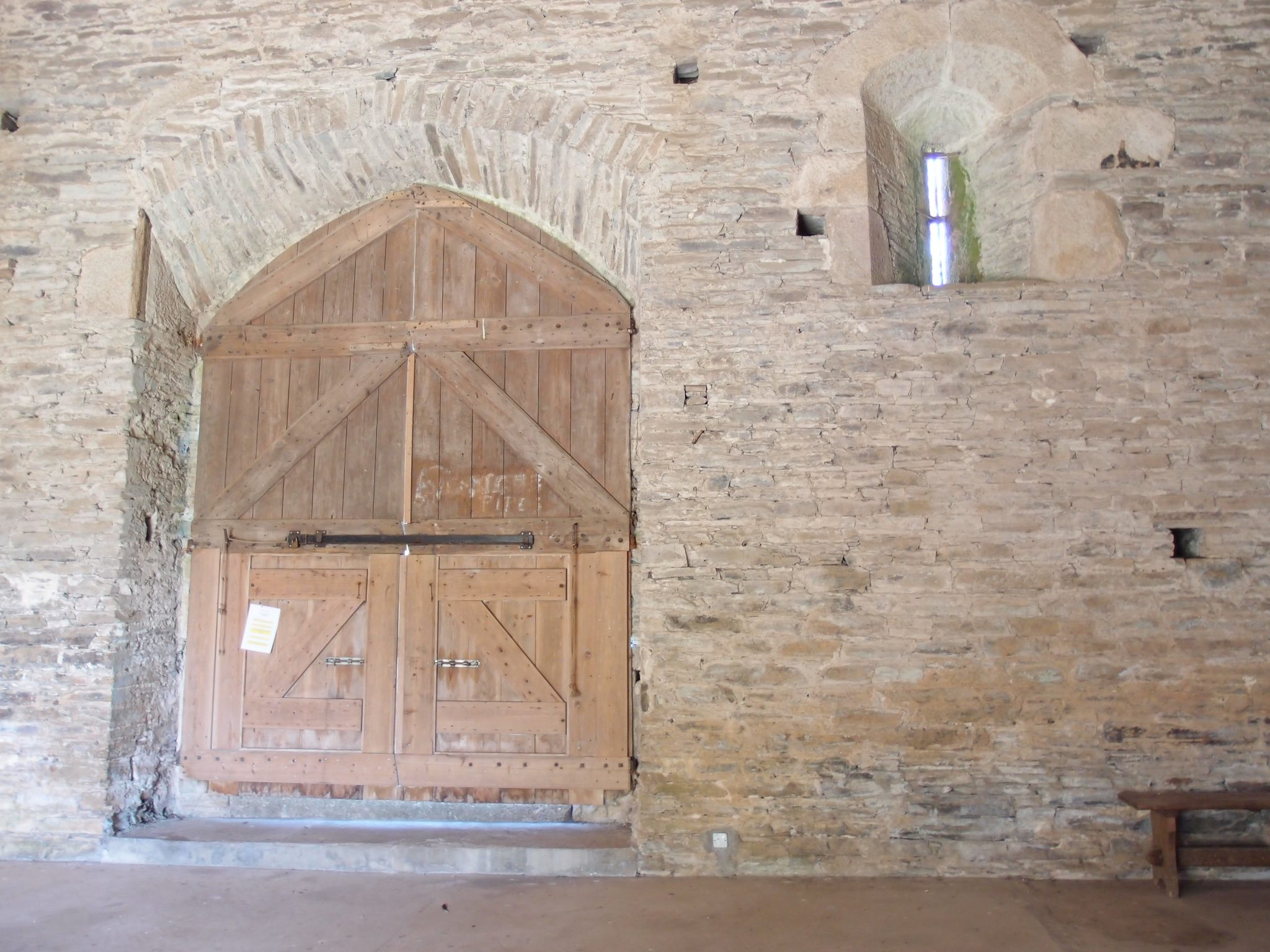 A massive door, in the Great Barn