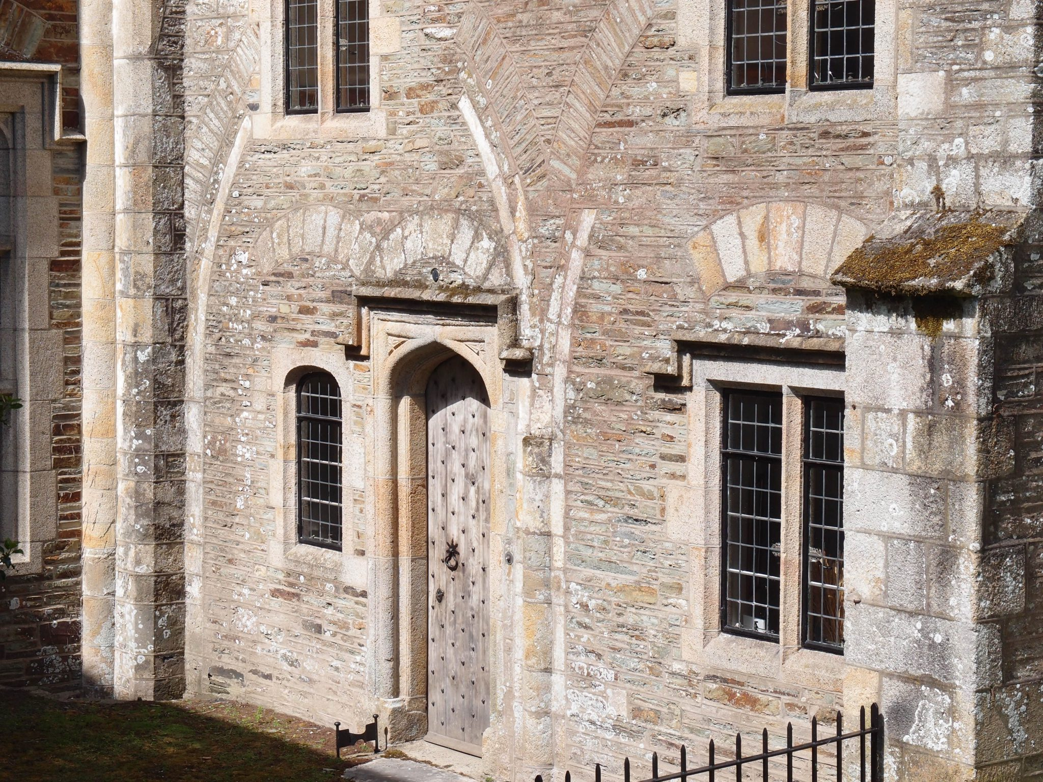 "To the east of the front entry is the kitchen wing, which was added by Grenville, and then expanded in the 18th century. Per The National Trust: ""This wing still reveals the retaining arches of the chapels that once issued from the east wall of the south transept at ground-floor level."""