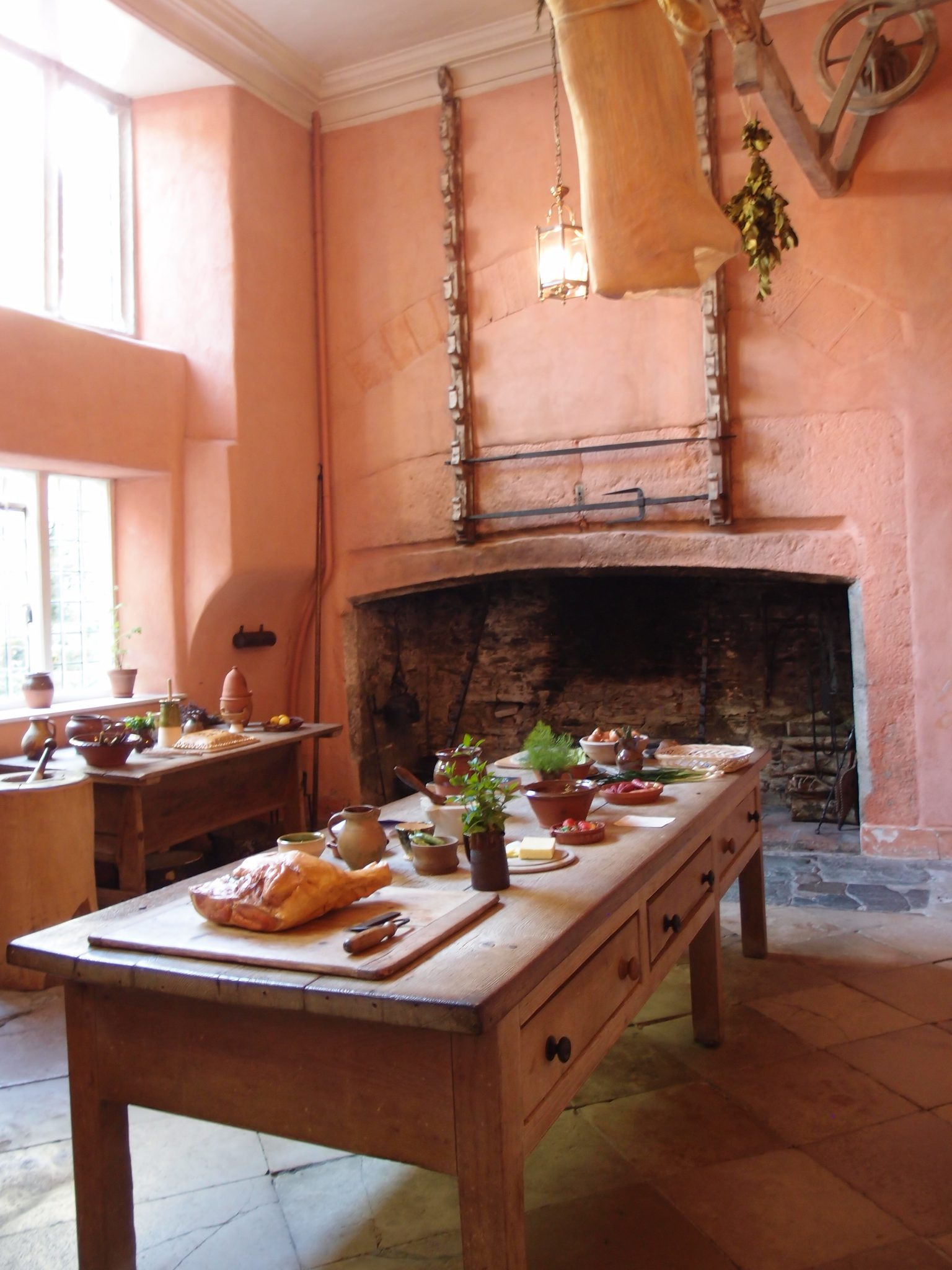 The Kitchen is in the Abbey's east wing, and was built by Sir Richard Grenville to absorb the monastic chancel. Two open Hearths dominate the room.