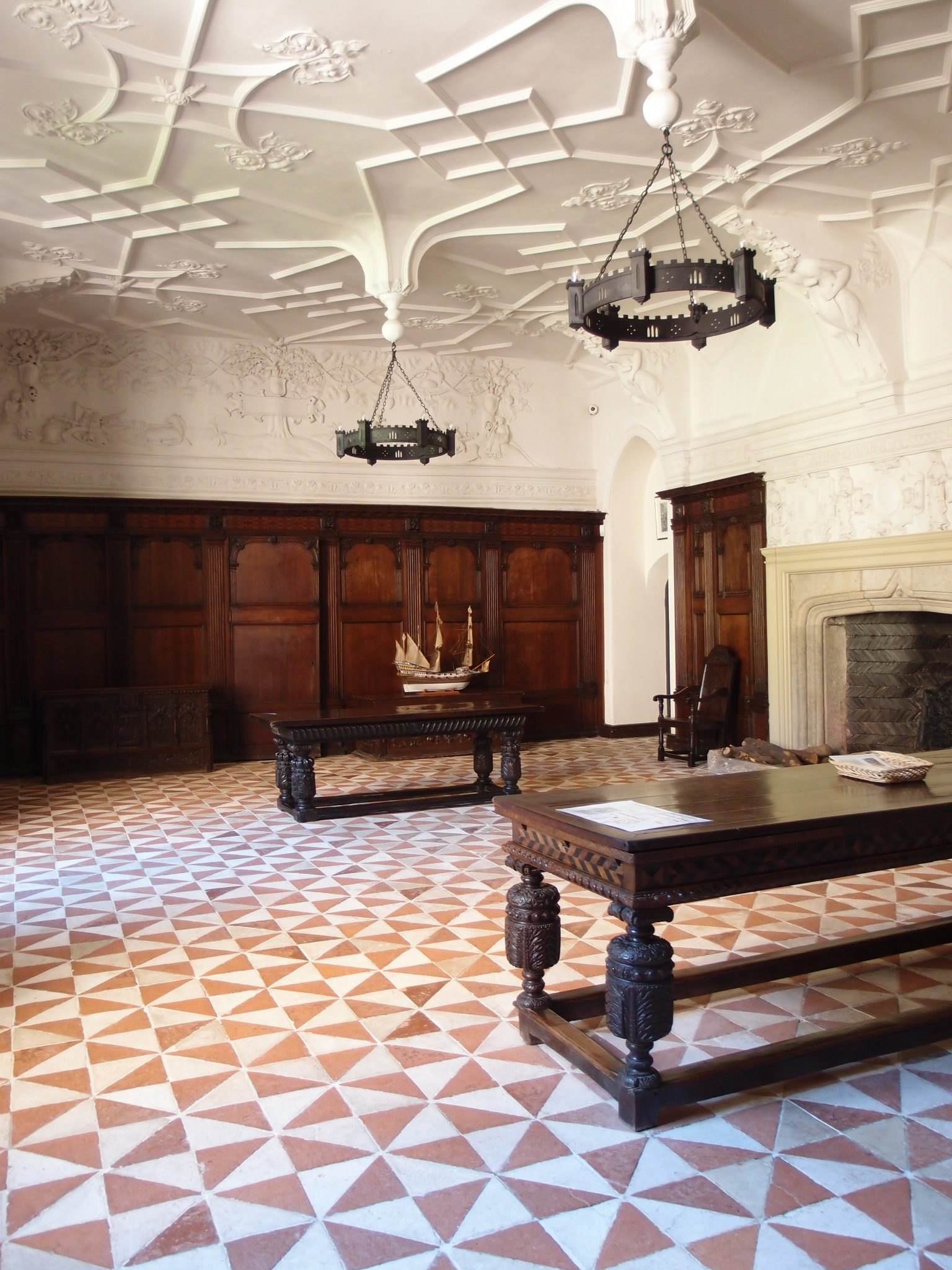 Every square inch of the Great Hall is decorated: from the plaster ceiling, right down to the stone-tiled floor.
