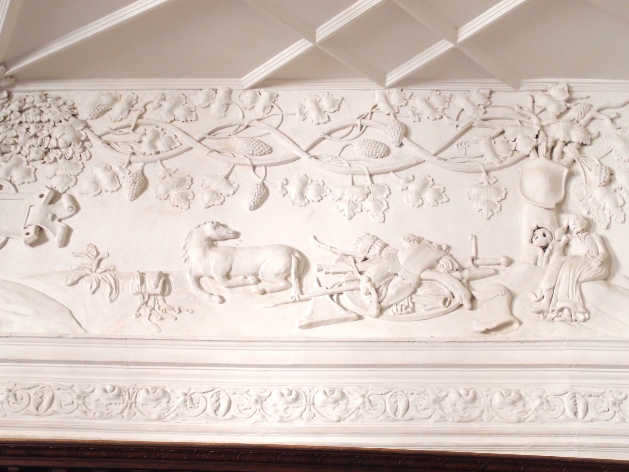 The Great Hall's upper walls are embellished with allegorical scenes. These plasterwork decorations have survived, exactly as they were, ever since Sir Richard Grenville's occupancy of the Abbey.