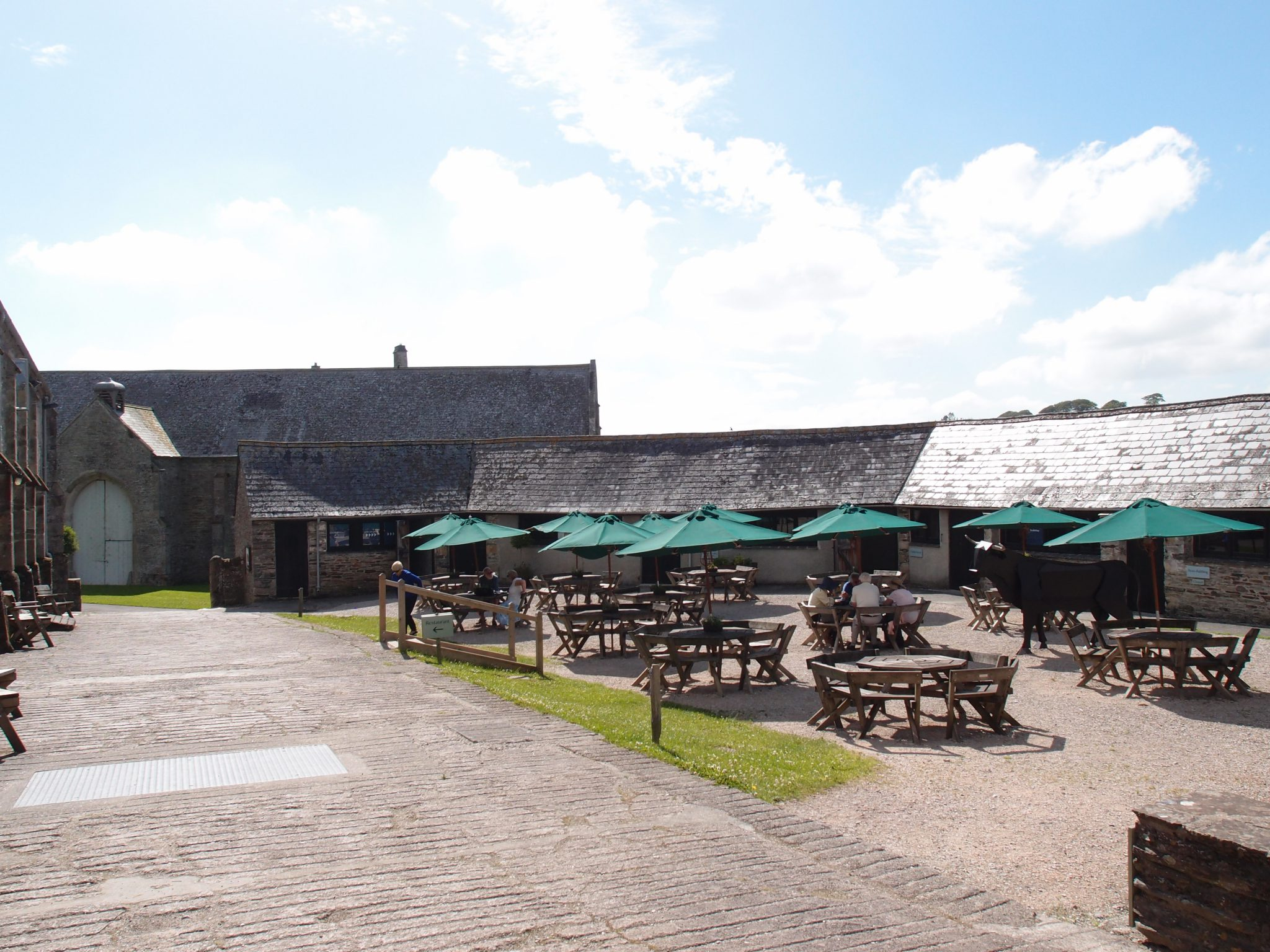 "The semi-octagonal Ox Yard is enclosed by sheds that were constructed during the 1790s. Today's outdoor Café stands where the ""Dung Yard"" once was…home to the Abbey's 22 oxen."