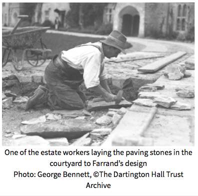 Circa 1933: an Estate worker laying paving stones in the Courtyard, to Farrand's design. Image courtesy of Dartington Hall.