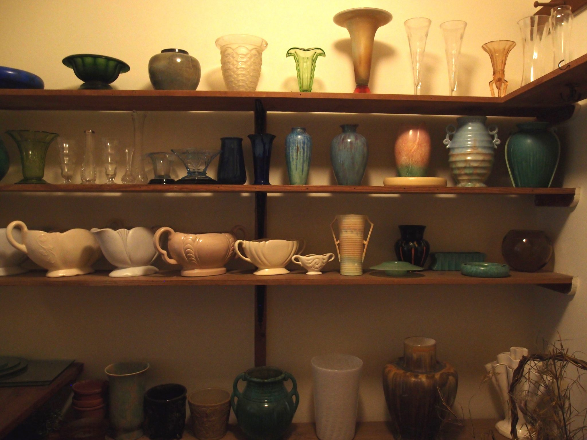 Vases, ready for fresh cut flowers, on shelves in the Flower Room. This was Dorothy's domain.