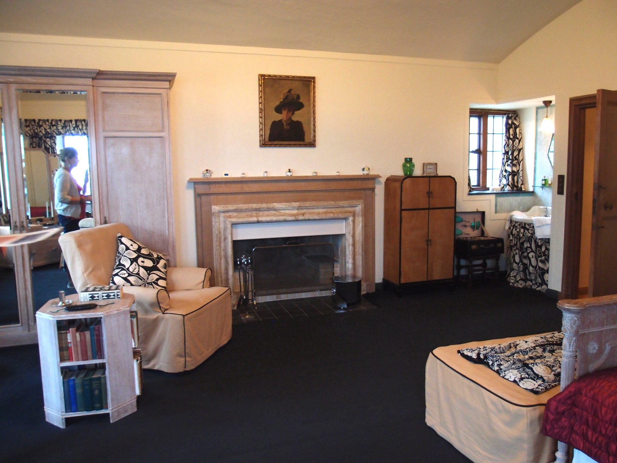 In Dorothy's Bedroom: the over-mantle painting is original to the House, as is the cupboard to the right of the fireplace. The near-black Axminster carpet was woven to replace the original.
