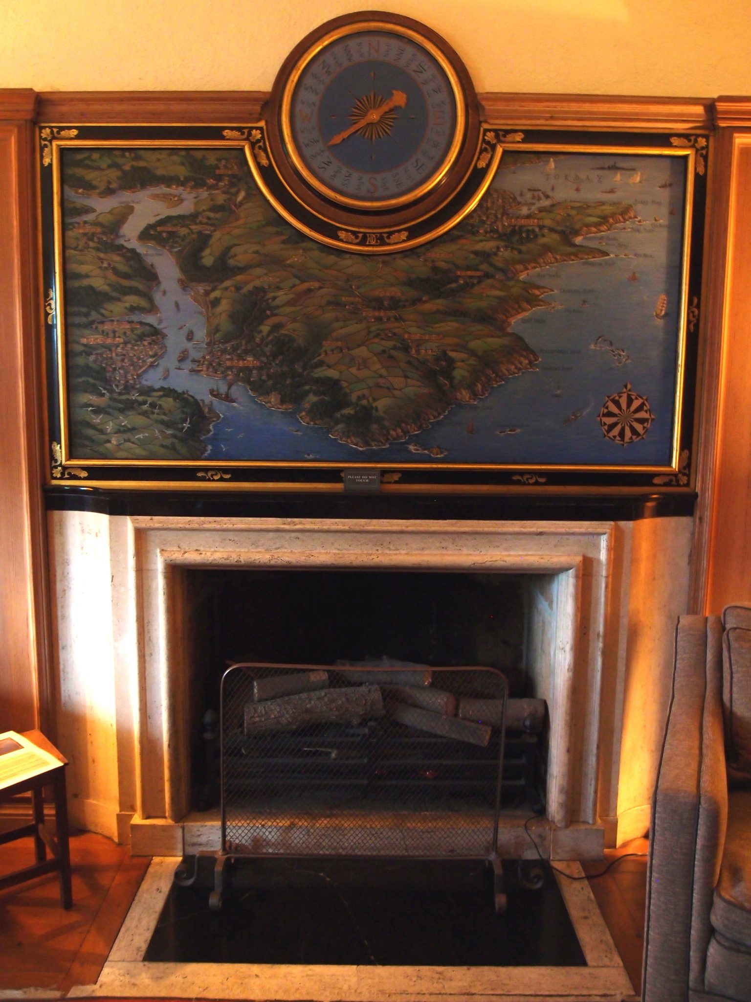 Library Hearth, with over-mantle painting of the Estate