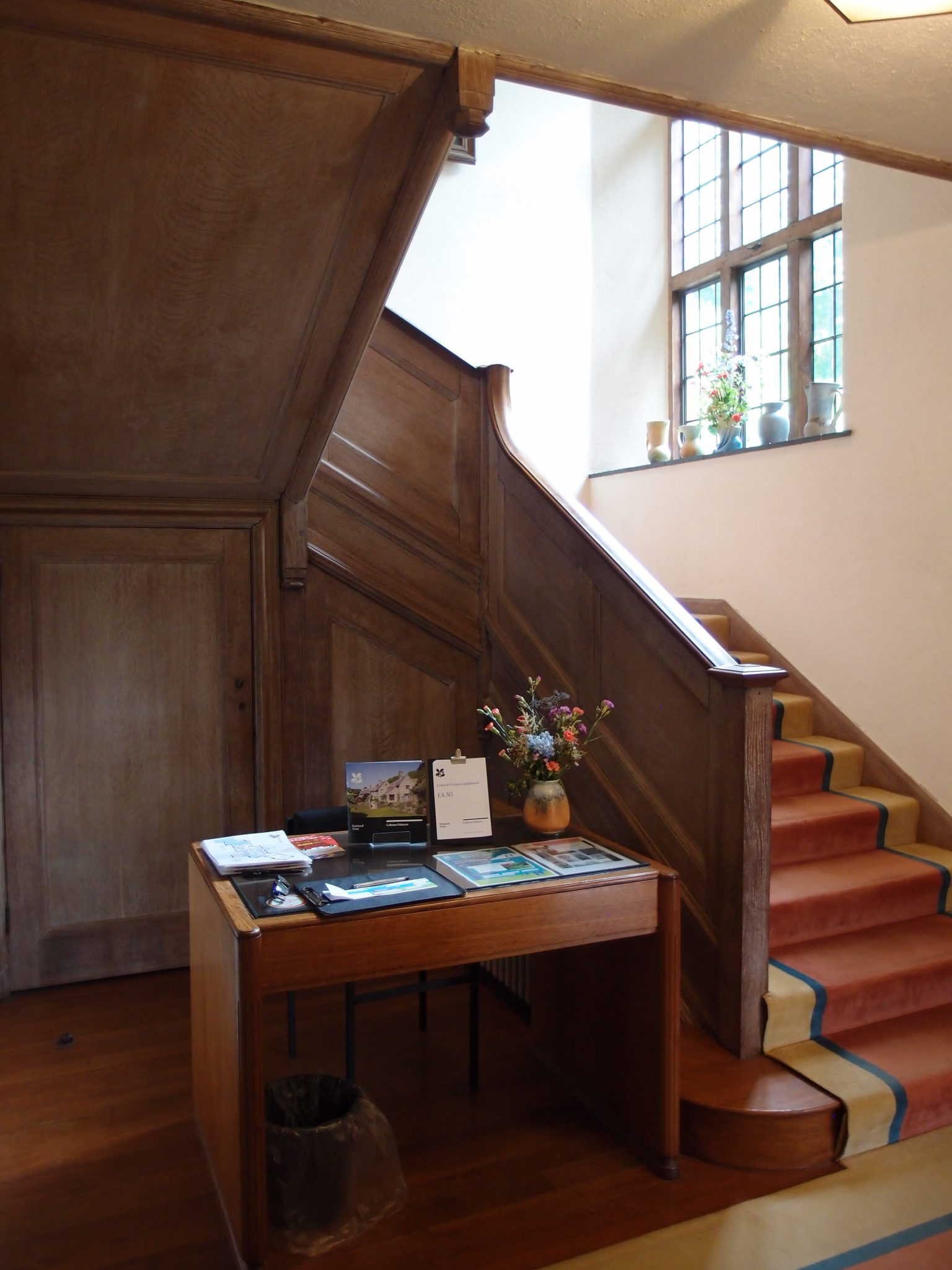 Main Staircase, Front Hall. The woodwork here is paneled pale, limed oak.