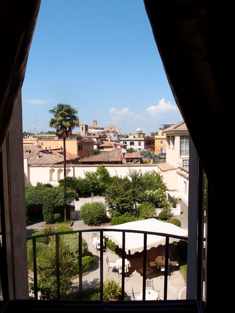 The VIEW over the Hotel Courtyard, and the rooftops of Trastevere, from my room at the Donna Camilla Savelli, on late afternoon of July 7, 2016.