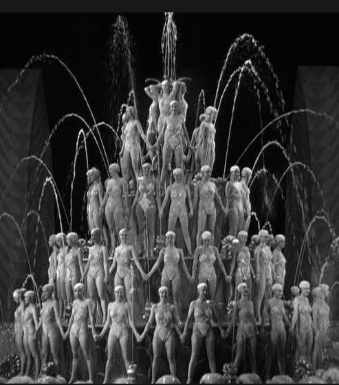 I mean REALLY: Don't La Scarzuola's Double Stairs just BEG to support a bevy of Busby Berkeley's Ladies? Here's a still from the 1933 film FOOTLIGHT PARADE. Jimmy Cagney. Joan Blondell. Ruby Keeler. When you're feeling glum, watch this movie….you'll be chipper in no time.