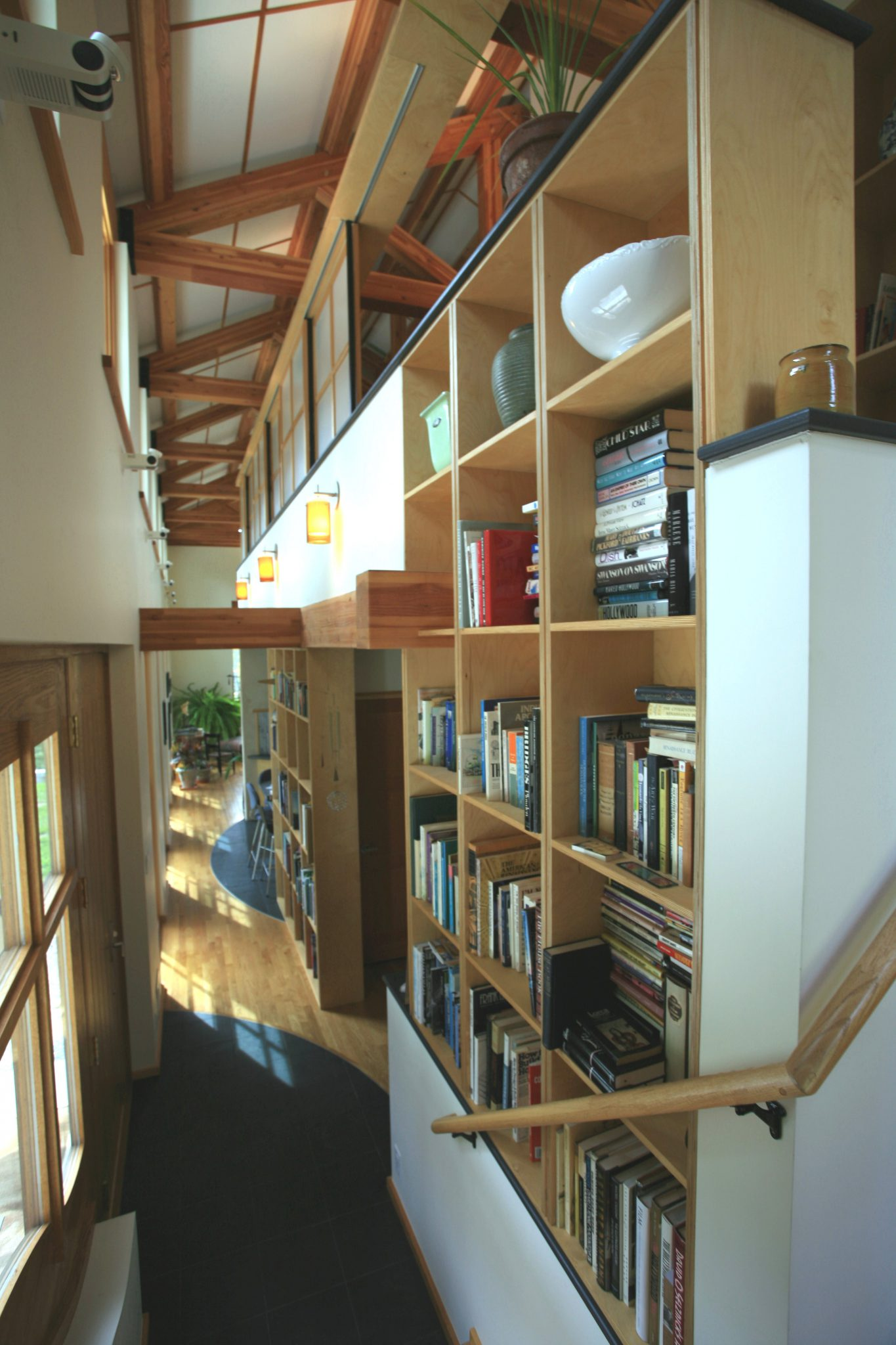 Bookshelves, shoehorned into every available nook and cranny.