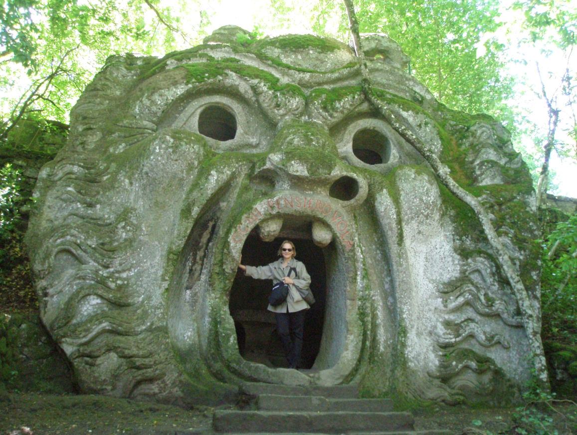 I used this photo of myself in the mouth of the Ogre at Bomarzo, as the lead for that article on Mannerist Gardens. You can be certain that Niki de Saint Phalle's HIGH PRIESTESS in her Tarot Garden is a direct descendant of Bomarzo's Ogre.
