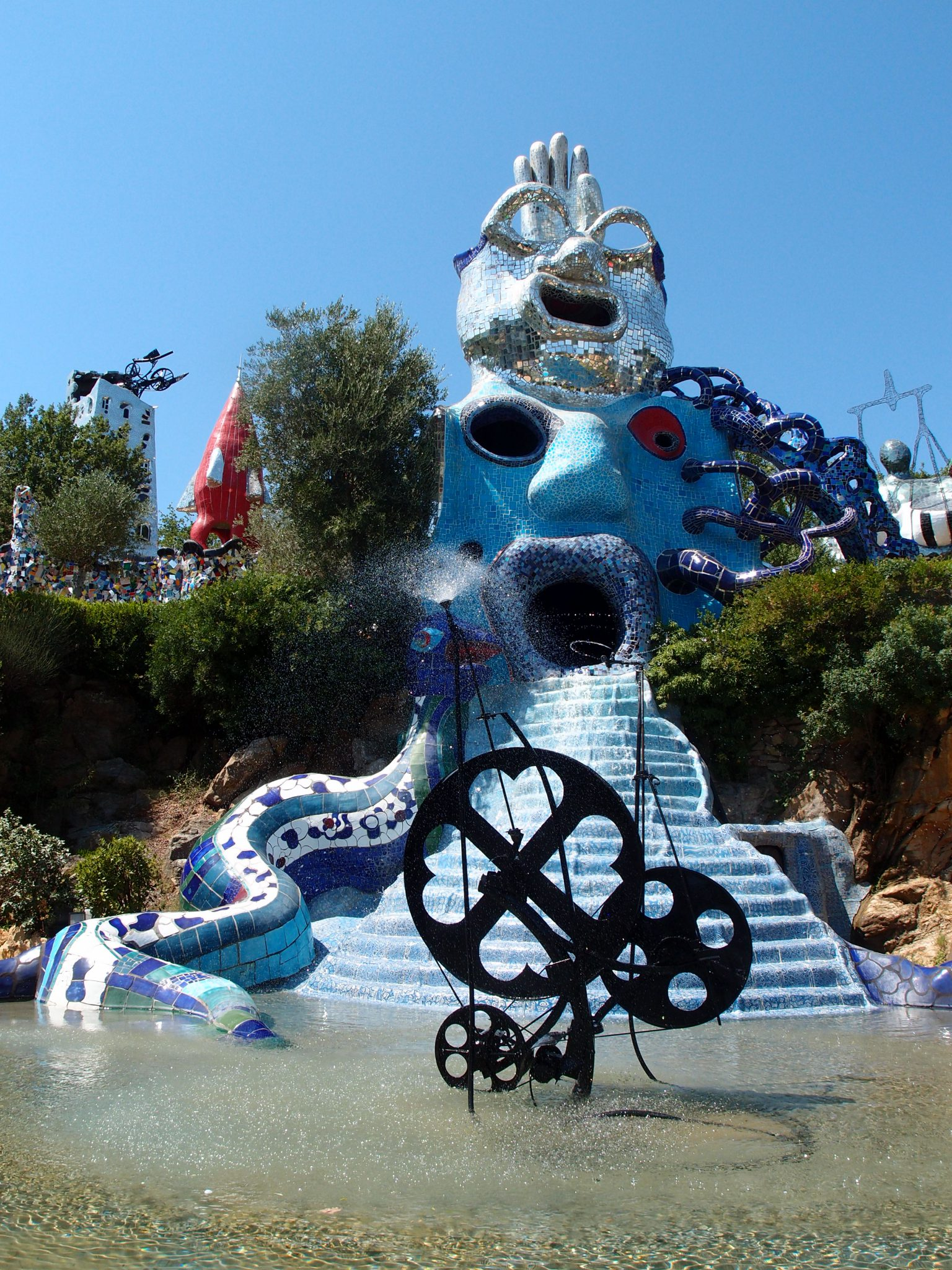 The High Priestess (in Blue), with Magician (in Silver), and the Wheel of Fortune (metal fountain in foreground)