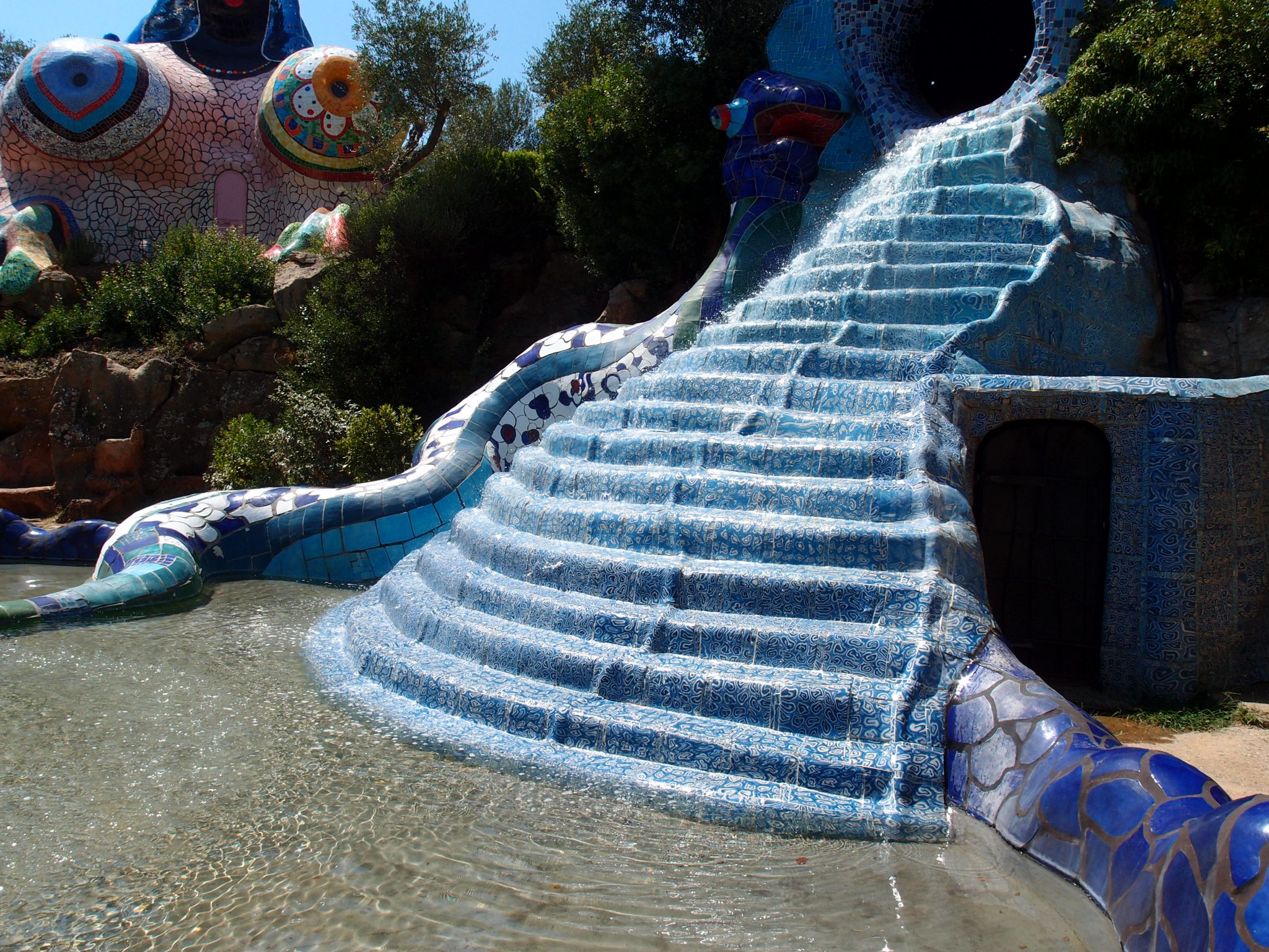 ...and cascades down a flight of tiled steps, into the pool of the Wheel of Fortune.