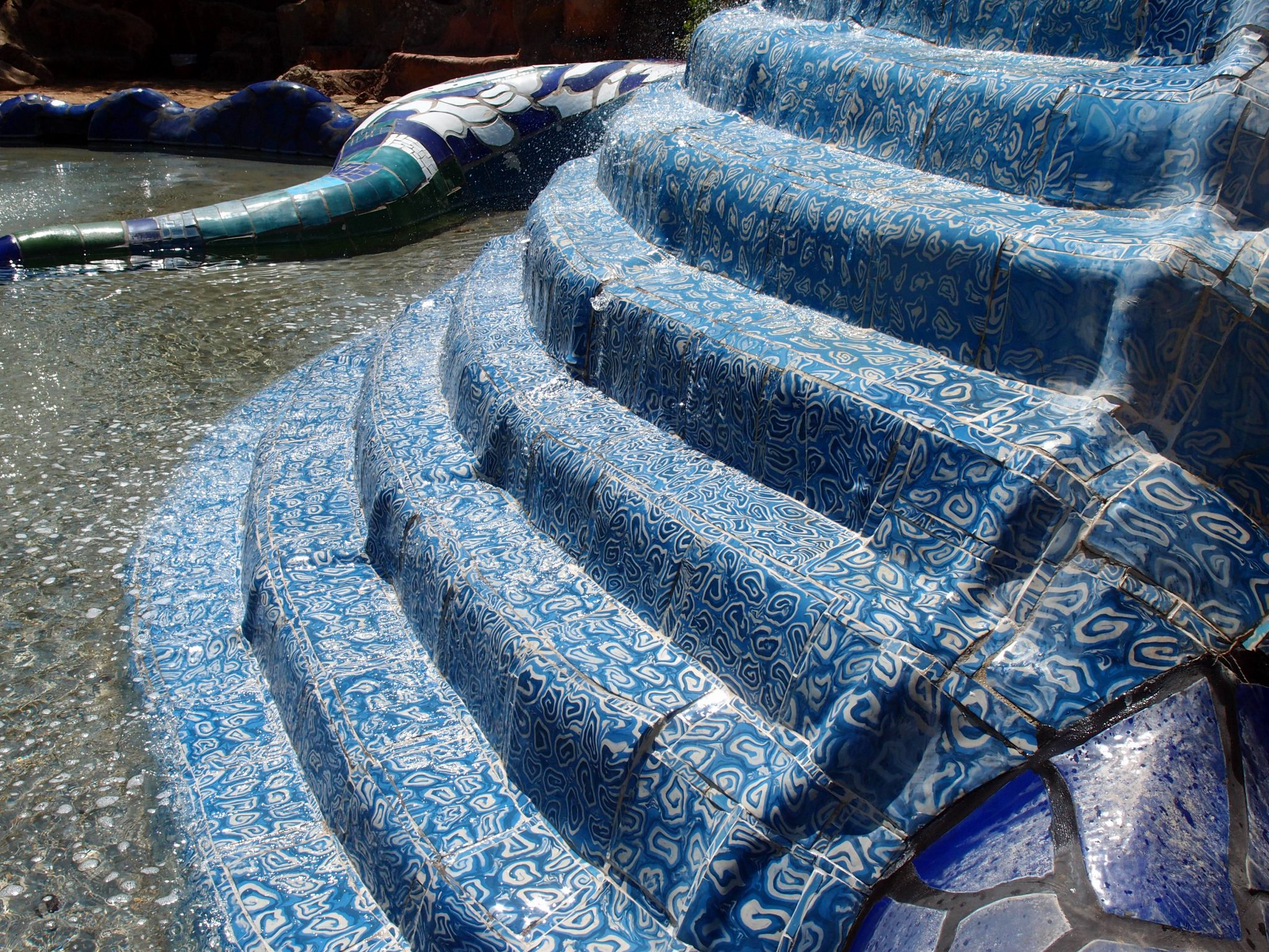 Detail of hand-made tiles, on the High Priestess water-cascade.