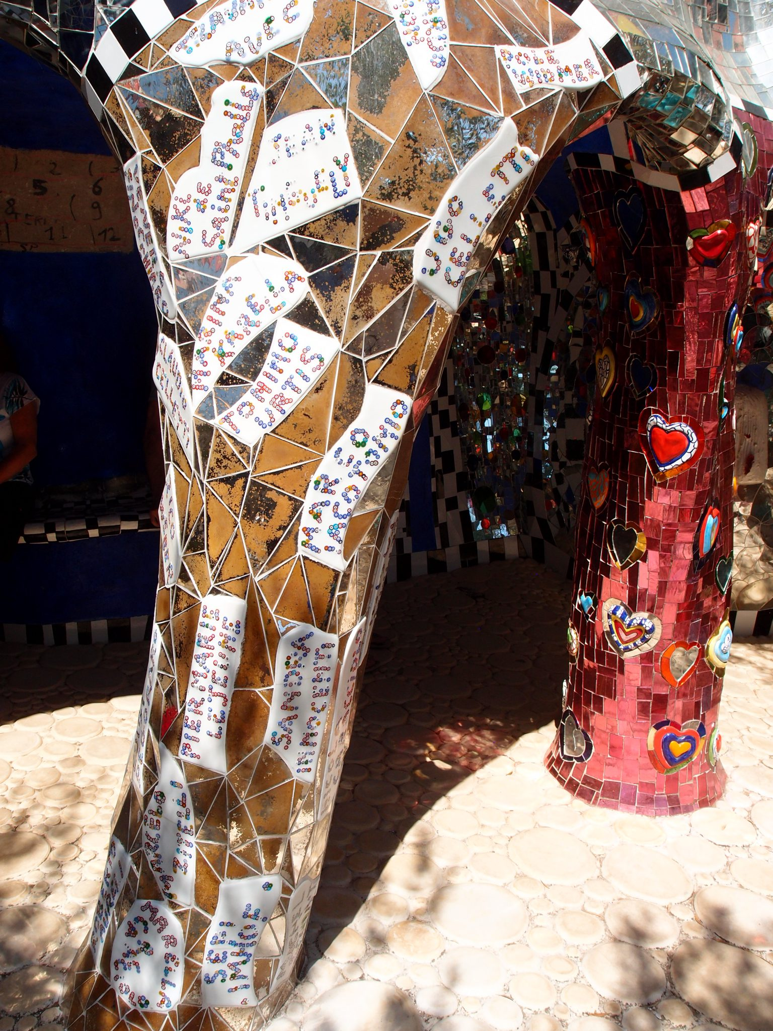 Back down now to The Emperor's Courtyard. Upon this column are the names of all the artists and craftspeople who built Niki de Saint Phalle's Tarot Garden.