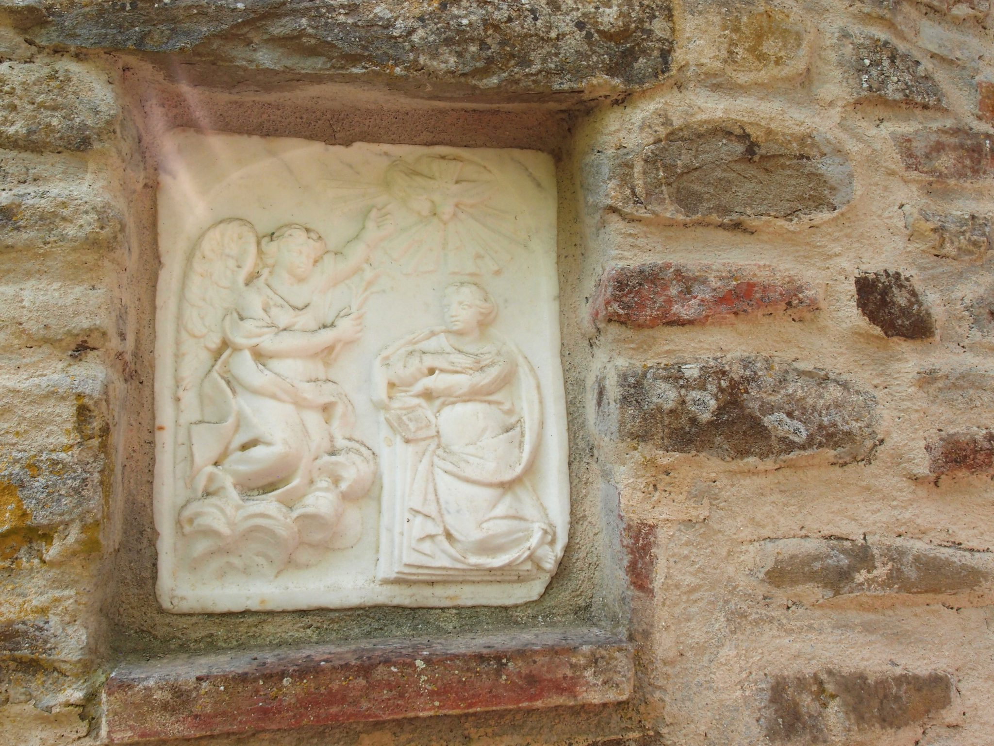A plaque of the Annunciation, on Convent's wall