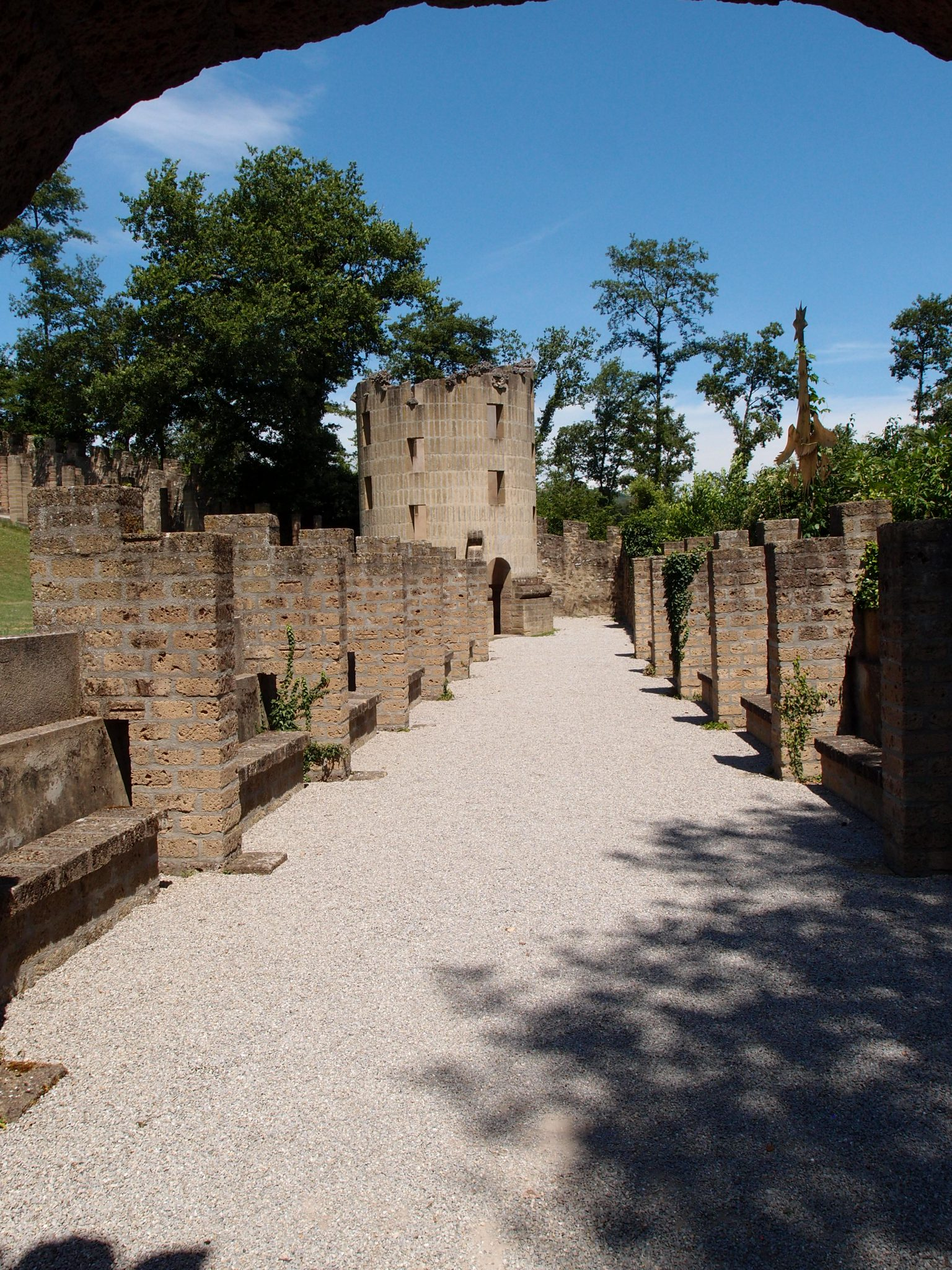 At the end of this trench is Buzzi's interpretation of the famous Ruined Column which is part of Desert de Retz, an exotic landscape garden, in Chambourcy, France.