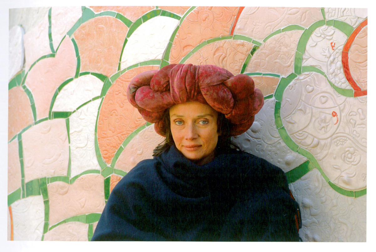 "Artist Niki de Saint Phalle, Born at Neuilly-Sur Siene, France in 1930. Died at La Jolla, California in 2002. Her ""art happenings,"" when she fired a rifle at her paintings and sculptures, made her a notorious figure on the international art scene in the early 1960s. By the mid 60s, her enormous, colorful sculptures of women, known as her ""Nanas,"" had brought her even greater fame. Image courtesy of Il Fondazione Giardino Dei Tarocchi"