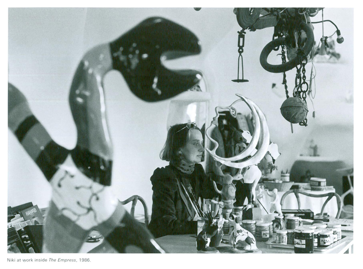 Niki, in 1986, at work at her home/studio, which was inside of The Empress. Here, she's completed a maquette of The Moon. Image courtesy of Il Fondazione Giardino Dei Tarocchi.